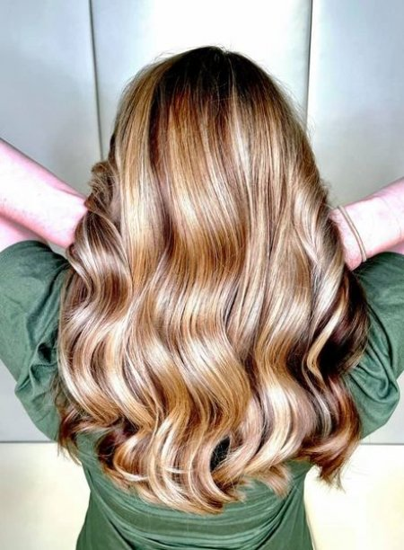 natural blonde highlights on a girl in green top