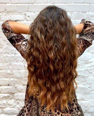 Girl with leopard spot dress and long mermaid hair at the klinik salon London