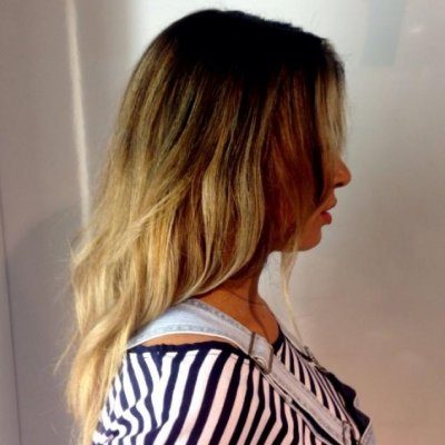Hair has been coloured using baliage technique to create depth to blonde tips.