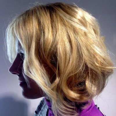 Tussled soft beachy waves created by Ghd Eclips Irons to give a soft finish.