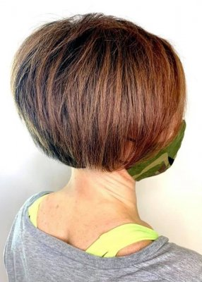 Girl with a brown bob and grey top