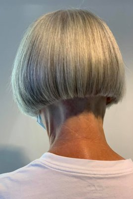 Bob cut from behind on a lady with a white tshirt and grey hair at the klinik salon London