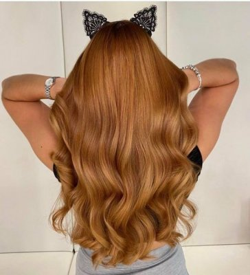 girl with long copper hair with cat ears on top at the klinik salon