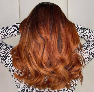 Long copper hair done at the klinik salon Londo