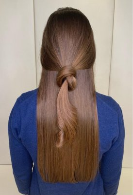 long hair tied into a knot