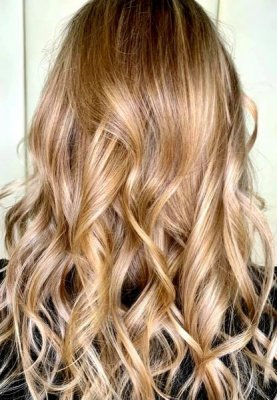 Long blonde hair fully highlighted at the klinik salon London